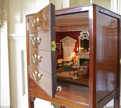 Miniature room inside a cabinet