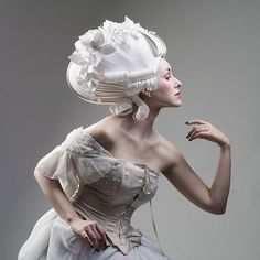 Papercraft wigs by Russian artist Asya Kozina that mimic the over-the-top hairstyles of men and women during the Baroque era.