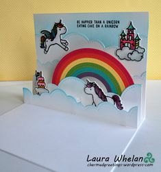 Magical interactive pop-up handmade card featuring Mama Elephant Unicorns & Rainbows stamps and dies and Lawn Fawn's Puffy Cloud Borders.