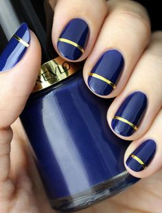 A Thin Gold Stripe More adhesive, this time atop your fresh new mani. Just cut the gold nail tape into your desired length and add across a solid polish job (once dried).  Get the look: Revlon polish ($5); gold nail tape ($1)