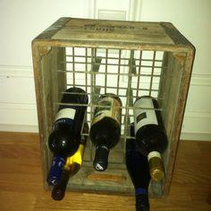 Antique milk bottle crate used for wine rack -