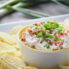 Crack Dip      16 ozs sour cream (regular or light)     1 pkg Hidden Valley® Original Ranch® Dips Mix     2 slices bacon (cooked and finely chopped, plus more for garnish)     1 cup shredded cheddar cheese     1 scallions (sliced)
