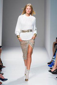 Rousteing is also a die-hard bling lover. Even the more subdued looks had something shiny going on: sliver houndstooth embroidered jackets; a silver mesh wrap skirt tucked chicly under an airy knit sweater; mini dresses covered in chain stripes; gold and silver embroidery covering denim jackets and minis. Courtesy of Imaxtree  - HarpersBAZAAR.com
