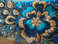 Handmade emboidery details with swarovsky crystall and gold beads