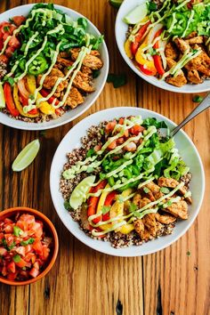 Make Mexican night fun and healthy with these chicken fajita quinoa bowls featuring spiced-up chicken, sautéed peppers and a creamy avocado goat cheese sauce. Spicy Recipes, Healthy Recipes, Healthy Food, Healthy Eating, Healthy Lunches, Healthy Dinners, Weeknight Meals, Chicken Recipes, Sauteed Peppers