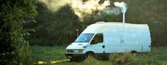 Amazing DIY van conversion even boasts a wood-burning stove and chimney
