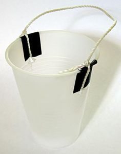 Physics science project Photograph of a cup with string tied to the top.