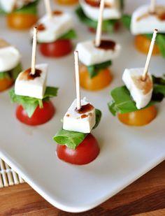 Caprese Skewers  INGREDIENTS: Cherry tomatoes, basil leaves, mozzarella cheese & balsamic vinegar