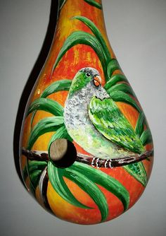 This is a beautiful hand painted gourd birdhouse that will add beauty to your home or garden.    This is a Monk Parakeet from South America
