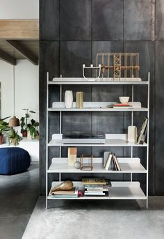 Simpel and elegant shelves modular system in powder coated steel designed by Cecilie Manz.