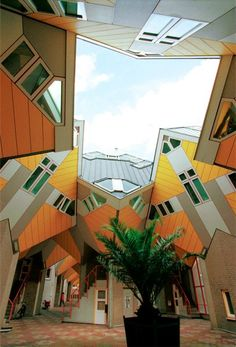 The Cube Houses of Piet Blom, 1984, Old Port, Rotterdam, the Netherlands.  Another pinner said one of the houses is a hostel, stayed there, and liked it.  (Update:  The entire complex is now a hostel.)