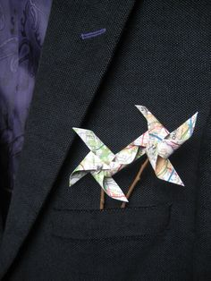 map pinwheels with natural stick brooch button hole by Meiorigami, £8.50  Great alternative to flowers, fits our map theme!