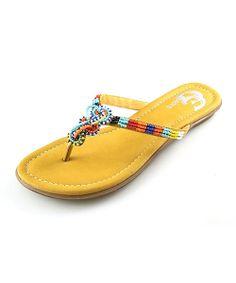 This sandal is the perfect comfort shoe topped off with just a hint of chic. Colorful beading adds all the spice any woman needs to this wonderful, weekend shoe.