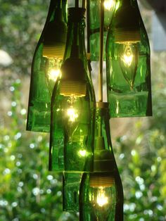 Recycled Wine Bottle Chandelier...ooh. I think this would look awesome with either all clear wine bottled or mixed colors. Not big on the all green.