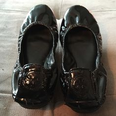 Tory Burch Black Patent Leather Eddie Flats Authentic Tory Burch Eddie Flats in size 7. Slightly used condition, imperfections pictured above. All Tory Burch logos still very visible. Inside lining and soles in great condition. Toes are slightly scuffed. Tory Burch Shoes Flats & Loafers