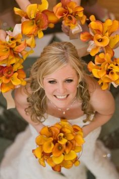 I wish I had this photo for myself! i was in love with our flowers and there arent enough good photos of them :( bridesmaid hold up their bouquets around the bride