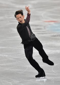 Daisuke Takahashi Photos Photos - Daisuke Takahashi of Japan performs in the men's short program during All Japan Figure Skating Championships at Saitama Super Arena on December 21, 2013 in Saitama, Japan. - 82nd All Japan Figure Skating Championships - Day One