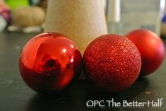 Tutorial on how to make several different types of Dollar Store Christmas Trees, including one using plastic spoons. - One Project Closer