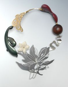 Bruce Metcalf  ||  Carved and painted maple, 24k gold- and nickel-plated brass, 14k yellow gold, sterling silver, rosewood,