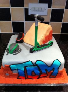 Scooter cake with accessories.