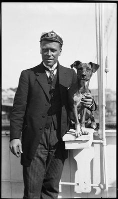 Sailing ship captain with with pet dog, c 1910