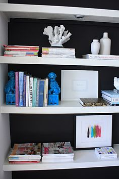 Black wall behind a white bookcase...oh yes.