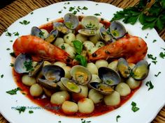 seafood gnocchi with clams and prawns