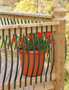 Aluminum Porch Railing Example With Red Flowers