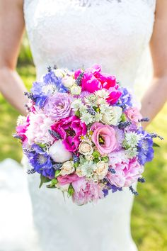 Wedding bouquet with pinks, purples, and blues.