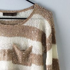 Cream & Taupe Sequin Sweater with Pocket This cream and taupe sequin sweater has a pocket on the upper left. Although it is a sweater, the material is light and it can easily be worn during any season. There are several pulls/snags on the material (see third and fourth pictures). It was purchased from the store with most of these snags already on it. Some can be easily fixed by tucking the excess thread into the inside, others are more permanent. Additional photographs available upon…
