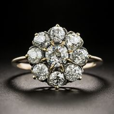Hand-fabricated in silver over 15ct. rose gold, hence of British origin, this classic ultra-sparkler, dating from the-turn-of-the-last-century, dazzles with a coruscating constellation of 9 bright white old mine-cut diamonds, 8 of which orbit around a .47 carat center stone. The sizable crown measures 9/16 inch diameter, the sleek knife-edge ring shank is currently size 7 1/4 and can only be sized up or down 1/2 a size. It is a bit on the delicate side and isn't for everyd...