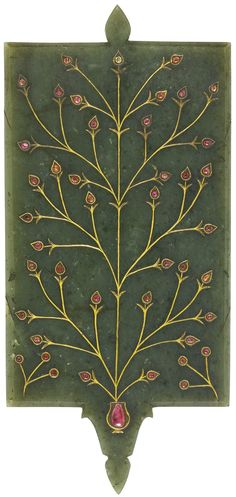 A MUGHAL GEM-SET JADE MIRROR FRAME, NORTH INDIA, 18TH CENTURY of carved jade in a rectangular format, the front with a recessed section for mirror, the border set in the kundan technique with pink gemstones, floral motifs in the border, the back decorated ensuite with a large floral stem emanating from a vase