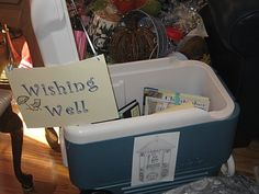 Beach theme bridal shower - cooler wishing well. Best idea!