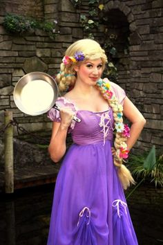 Princess Rapunzel, ready with her frying pan, ALSO A LOOKING OUT THE WINDOW PIC