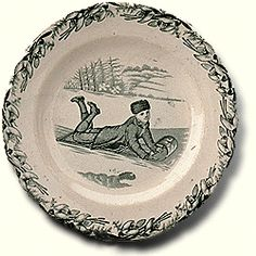 """1882-1897 Scottish Plate at the Canadian Museum of Civilization, Gatineau - From the curators' comments: """"In the nineteenth century, Canadian scenes were as appealing to other nations as Canadian sports are today. Earthenware dishes with Canadian scenes, including """"Canadian Sports"""" scenes like this one of a boy tobogganing, were produced in British potteries not only for buyers in what we now call Canada but also for an even larger market in the United States."""""""