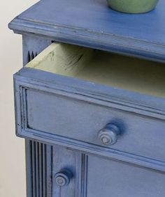 "Greek Blue.  ""This is a warm blue without any green in it. It is a colour found throughout the Mediterranean, often faded and distressed on shutters and woodwork. It has a chalky look about it yet it is a strong positive colour.""    Really think I need to find *something* to paint this color ;)"