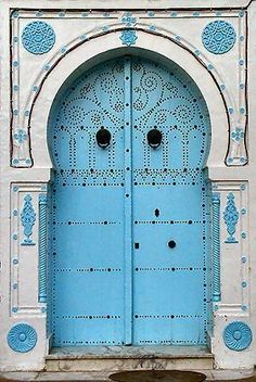 Blue doors, commonly found in the Mediterranean and North Africa, are thought to repel evil. Tunisia (I will have a blue door one day)