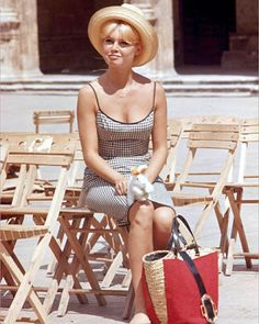 Brigitte Bardot in gingham (her signature) sundress with sun hat and tote bag.