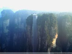 Bailong Elevator in Hunan, China. Glass elevator cars rise nearly 1,070 feet up a sheer cliff as they transport folks to a scenic area overlooking the green-swathed valley below. In two minutes time, guests are treated to some of the park's best scenery, including scenic lakes and the distinct sandstone pillars the region is known for.