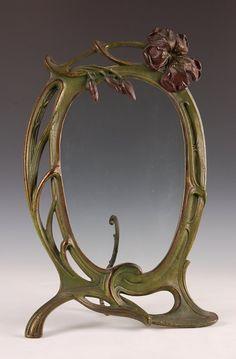A CLASSIC CAST IRON ART NOUVEAU FRAME CIRCA 1900