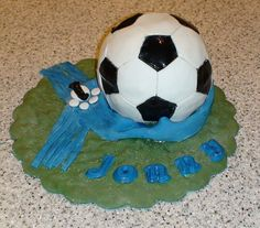 Looks like fondant icing, which I dont care for, but also looks cool!                                                                                                               Soccer cake             by        gnats7143      on        Flickr..