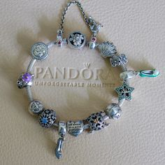 Pandora has a great Disney collection. This is my princess collection bracelet from Pandora. Charms from Ariel. Tinkel Bell, Cinderella, Beauty and the Beast and Snow White. Pandora Bracelet Charms, Princess Collection, My Princess, Beauty And The Beast, Ariel, Cinderella, Snow White, Take That, Charmed