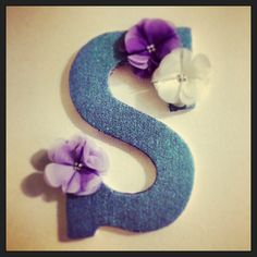 """Successful Pinterest project: plain letter """"S"""" from Michael's painted with Mod Podge and glitter, flower embellishments from Martha Stewart."""