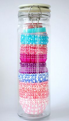 To keep baking supplies organized, store cupcake wrappers in a spaghetti jar. This also creates a fun decorative piece for the kitchen or pantry.