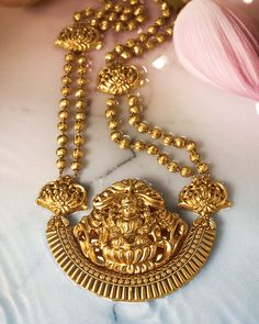 Statement necklace with lakshmi pendant by Tanishq. Gold jewellery.