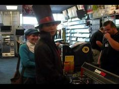 This is so funny! It's three people cosplaying as Luke, the Professor, and Future Luke and they are buying Professor Layton and the Diabolical Box. Towards the end is hilarious. The video is kind of low quality, by the way.