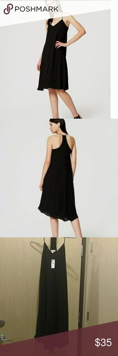 NWT LOFT black strappy racerback dress New with tags black racerback midi dress. Fully lined in a very flowy material this is the perfect evening or date dress. Size 0 but the only place it really hugs you is in the chest so if you have fuller hips/tummy but a smaller bust this could work for you. LOFT Dresses Midi