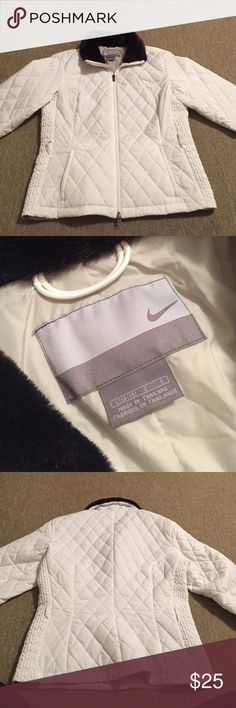 Nike winter coat White winter coat. Few very faint stains if you look close. Says it's a large (12-14) but would be very tight I think so would recommend it for size 4-6 people Nike Jackets & Coats