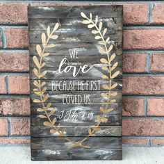 We love because he first loved us wood sign by CoastalCraftyMama