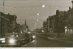 1948 Christmas lights use to be strung across the street.